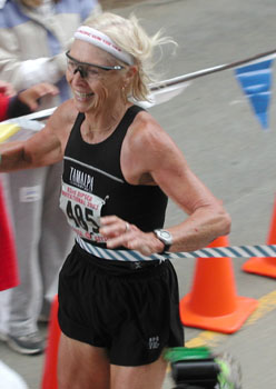 Melody Anne-Shultz (1999 and 2003 Dipsea Champion) breaks the tape for her second Dipsea victory in 2003.